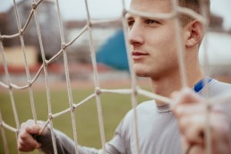 Young man in soccer goal