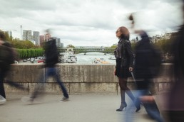 France, Paris, people walking on a bridge