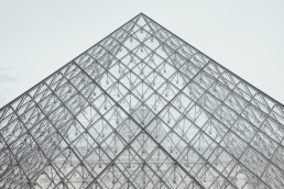 France, Paris, Louvre, part of glass pyramid in front of the old building