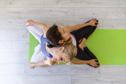 Prenatal yoga, female yoga instructor, reclining