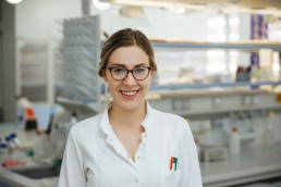 Portrait of smiling laboratory technician in lab