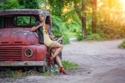 Female model posing with a car